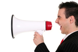 bigstockphoto_Man_Shouting_Through_Megaphone_2233138